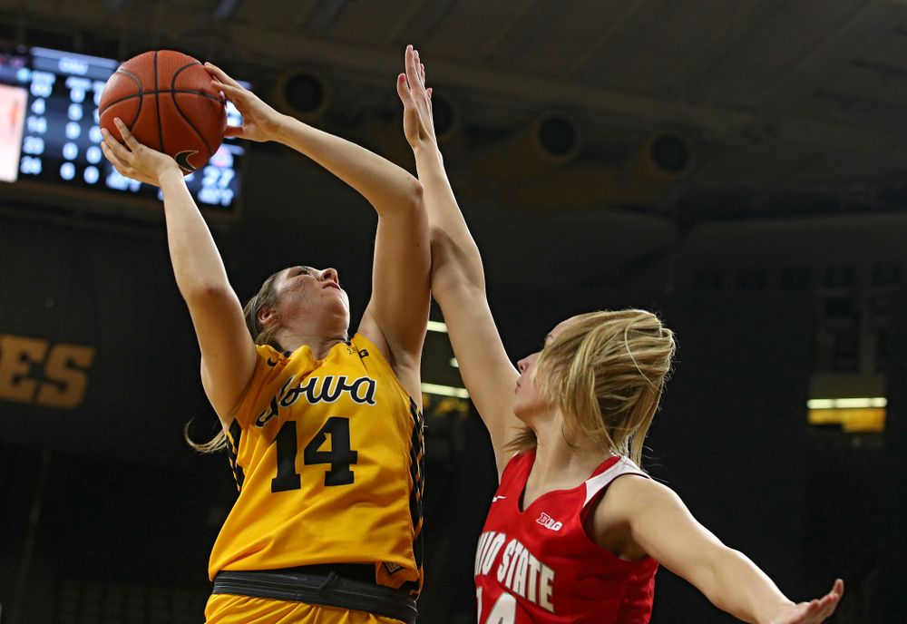 Iowa Hawkeyes guard Mckenna Warnock (14) makes a basket during the second quarter of their game at Carver-Hawkeye Arena in Iowa City on Thursday, January 23, 2020. (Stephen Mally/hawkeyesports.com)