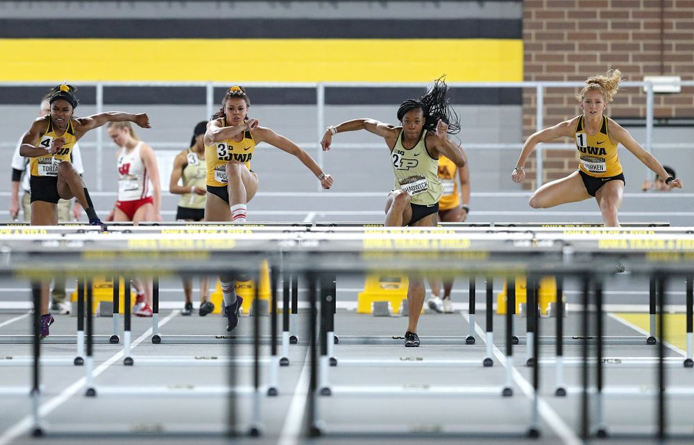 Iowa's Tionna Tobias (from left), Dallyssa Huggins, and Kylie Morken run the women's 60 meter hurdles premier preliminary event during the Larry Wieczorek Invitational at the Recreation Building in Iowa City on Saturday, January 18, 2020. (Stephen Mally/hawkeyesports.com)