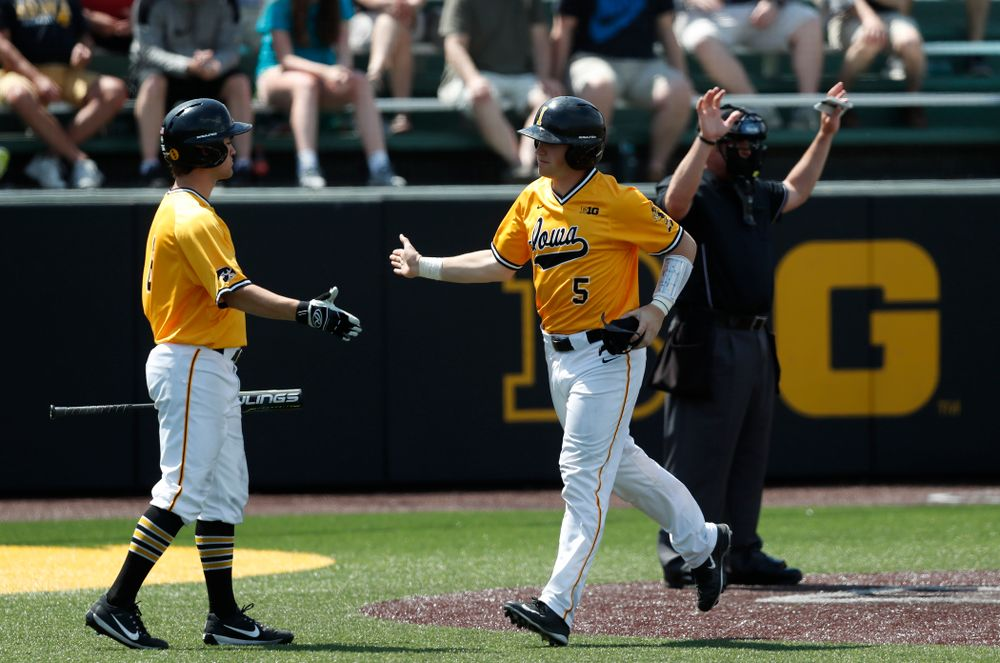 Iowa Hawkeyes catcher Tyler Cropley (5) scores against the Oklahoma State Cowboys Sunday, May 6, 2018 at Duane Banks Field. (Brian Ray/hawkeyesports.com)