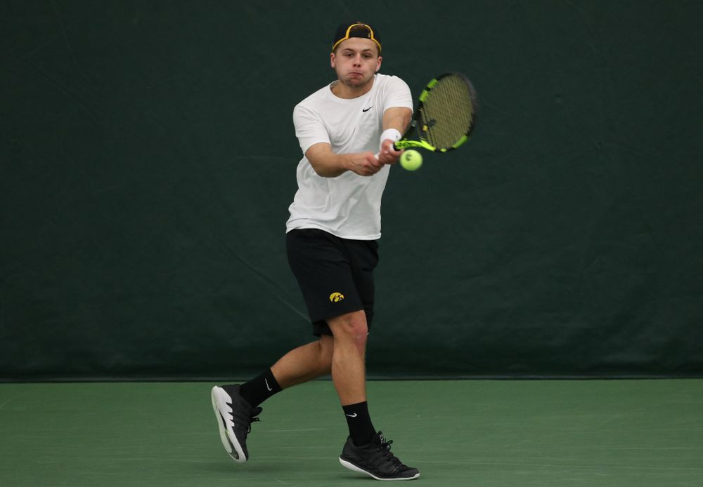 Iowa's Will Davies against UMKC Friday, February 15, 2019 at the Hawkeye Tennis and Recreation Complex. (Brian Ray/hawkeyesports.com)