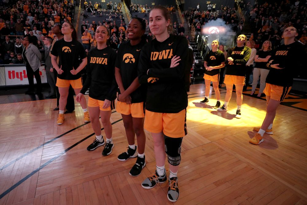Iowa Hawkeyes guard Kate Martin (20) and guard Tomi Taiwo  (1) against the Minnesota Golden Gophers Thursday, February 27, 2020 at Carver-Hawkeye Arena. (Brian Ray/hawkeyesports.com)