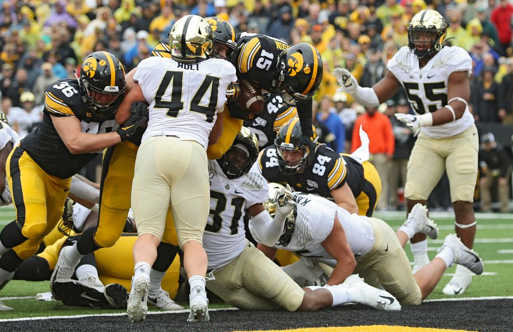 Iowa Hawkeyes running back Tyler Goodson (15) scores a touchdown during the third quarter of their game at Kinnick Stadium in Iowa City on Saturday, Oct 19, 2019. (Stephen Mally/hawkeyesports.com)