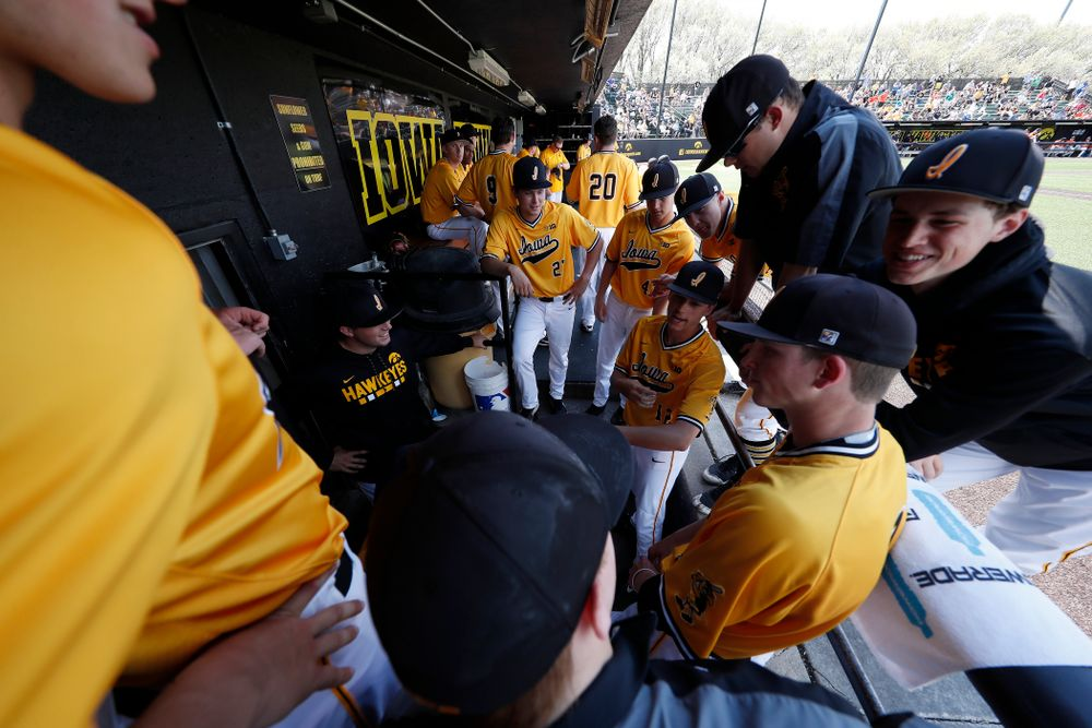 Iowa Hawkeyes pitcher Cole McDonald (11) and pitcher Nick Nelsen (12) give the scouting report on the Oklahoma State Cowboys relief pitcher Sunday, May 6, 2018 at Duane Banks Field. (Brian Ray/hawkeyesports.com)