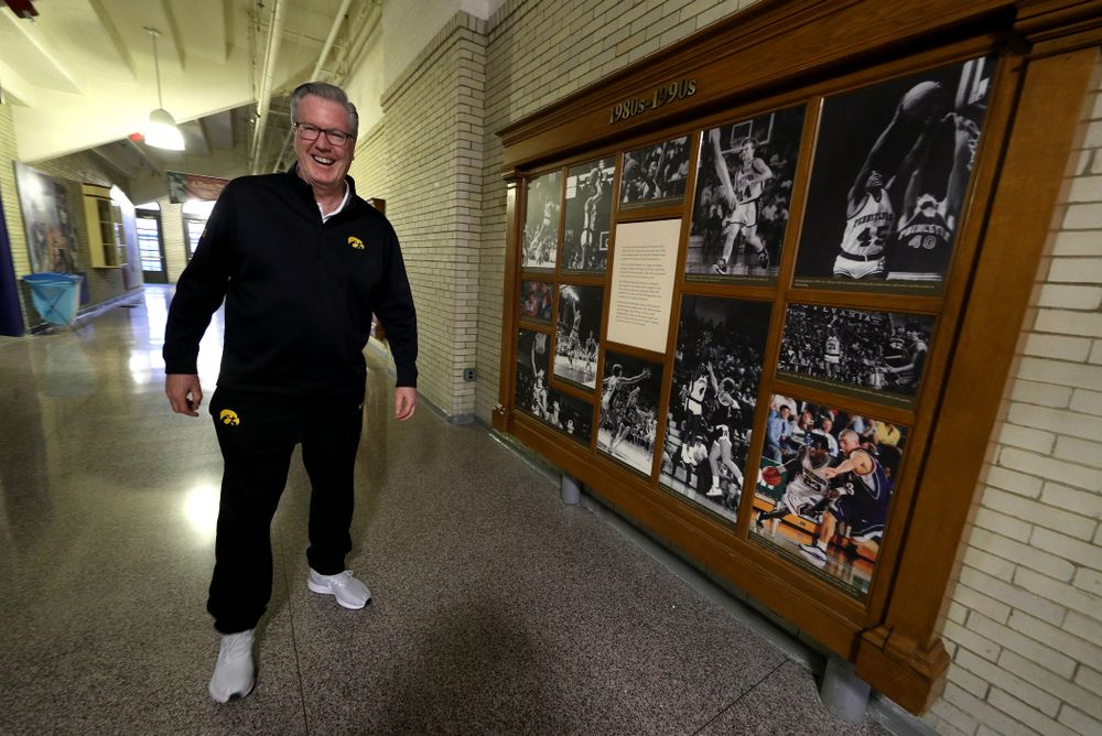 Iowa Hawkeyes head coach Fran McCaffery stands by a display with his photo in it before practice at the Palestra Friday, January 3, 2020 in Philadelphia. (Brian Ray/hawkeyesports.com)