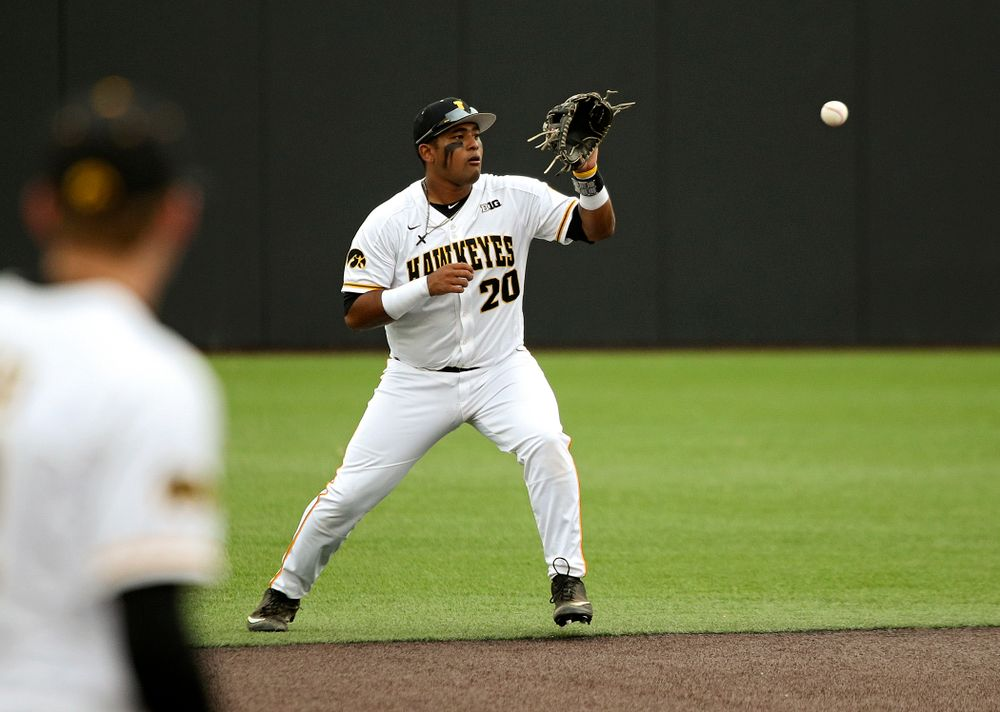 Iowa infielder Izaya Fullard (20) fields a ground ball before throwing to first for an out during the sixth inning of their college baseball game at Duane Banks Field in Iowa City on Wednesday, March 11, 2020. (Stephen Mally/hawkeyesports.com)