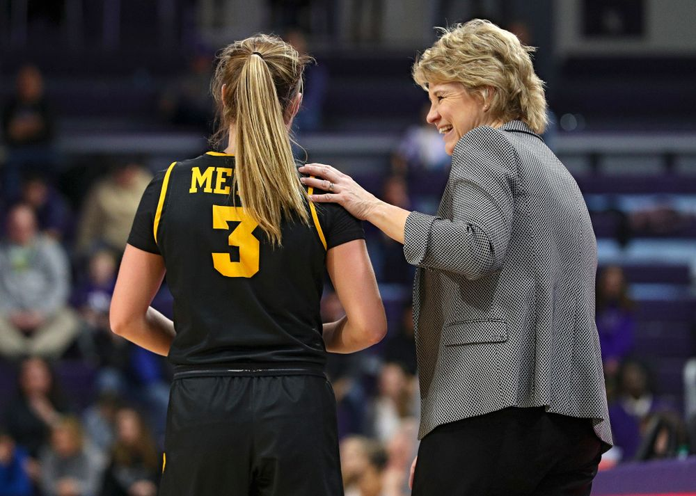 Iowa Hawkeyes guard Makenzie Meyer (3) shares a laugh with head coach Lisa Bluder during the third quarter of their game at Welsh-Ryan Arena in Evanston, Ill. on Sunday, January 5, 2020. (Stephen Mally/hawkeyesports.com)