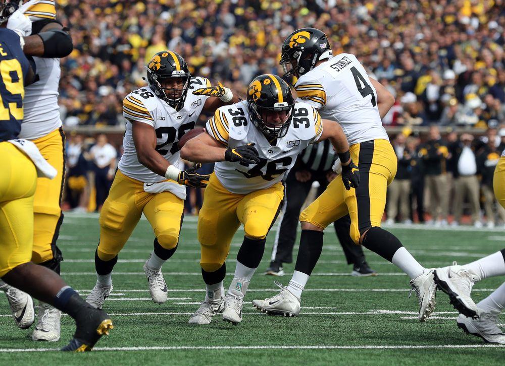 Iowa Hawkeyes fullback Brady Ross (36) and running back Toren Young (28) against the Michigan Wolverines Saturday, October 5, 2019 at Michigan Stadium in Ann Arbor, MI. (Brian Ray/hawkeyesports.com)
