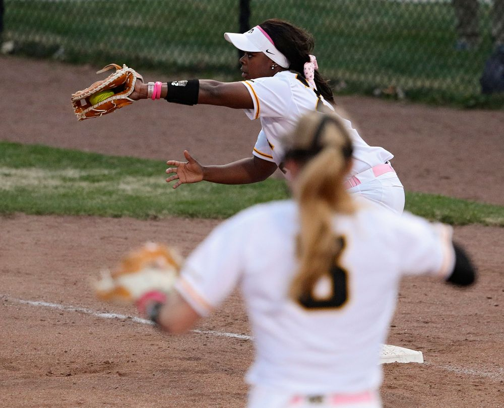 Iowa first baseman DoniRae Mayhew (24) pulls in a throw as they turn a double play as pitcher Allison Doocy (3) looks on during the fifth inning of their game against Iowa State at Pearl Field in Iowa City on Tuesday, Apr. 9, 2019. (Stephen Mally/hawkeyesports.com)