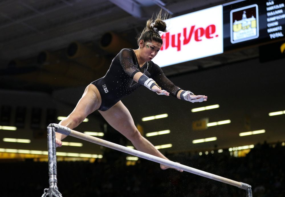 Iowa's Nicole Chow competes on the bars against Illinois Saturday, February 16, 2019 at Carver-Hawkeye Arena. (Brian Ray/hawkeyesports.com)