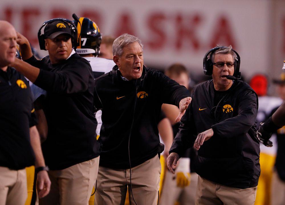 Iowa Hawkeyes head coach Kirk Ferentz and quarterbacks coach Ken O'Keefe