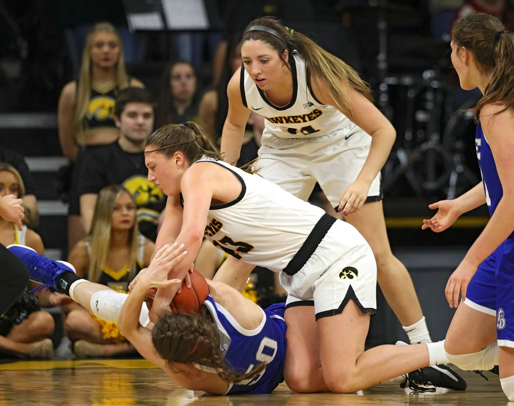 Iowa Hawkeyes forward Amanda Ollinger (43) hangs on to a tie ball during the third quarter of their game at Carver-Hawkeye Arena in Iowa City on Saturday, December 21, 2019. (Stephen Mally/hawkeyesports.com)