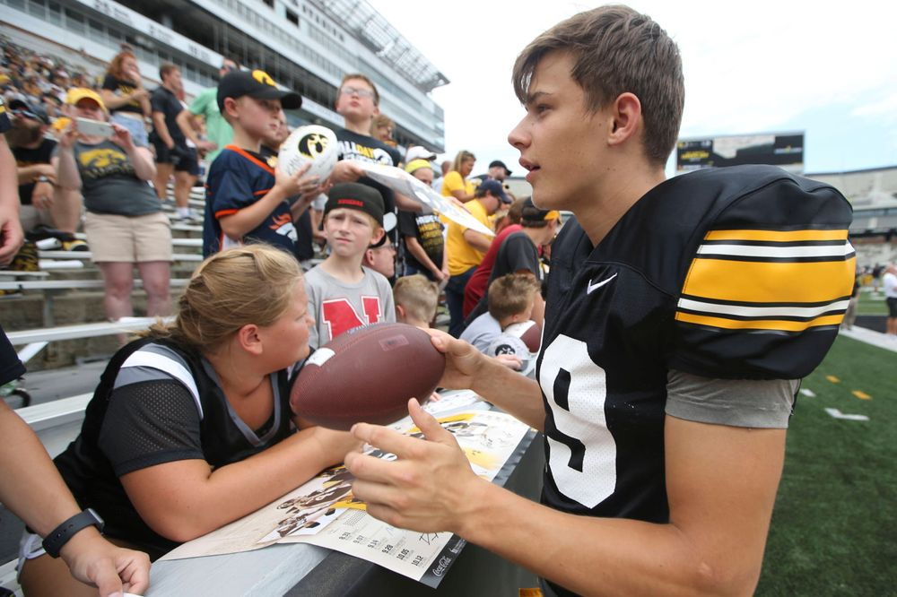 Iowa Hawkeyes wide receiver Jackson Ritter (29) signs autographs during Kids Day at Kinnick Stadium on Saturday, August 10, 2019. (Lily Smith/hawkeyesports.com)