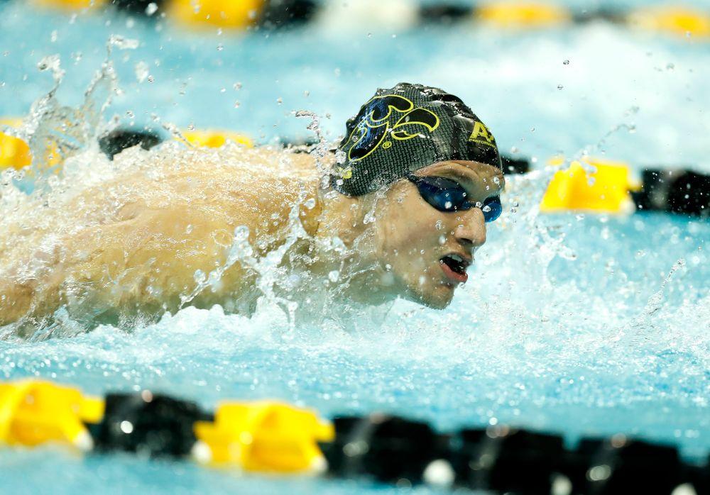 Jerzy Twarowski swims the 100 yard butterfly