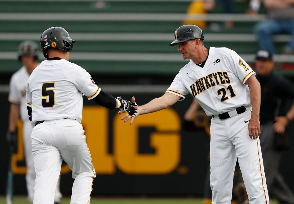 Iowa Hawkeyes catcher Tyler Cropley (5) is congratulated by head coach Rick Heller after hitting a home run against the Missouri Tigers Tuesday, May 1, 2018 at Duane Banks Field. (Brian Ray/hawkeyesports.com)