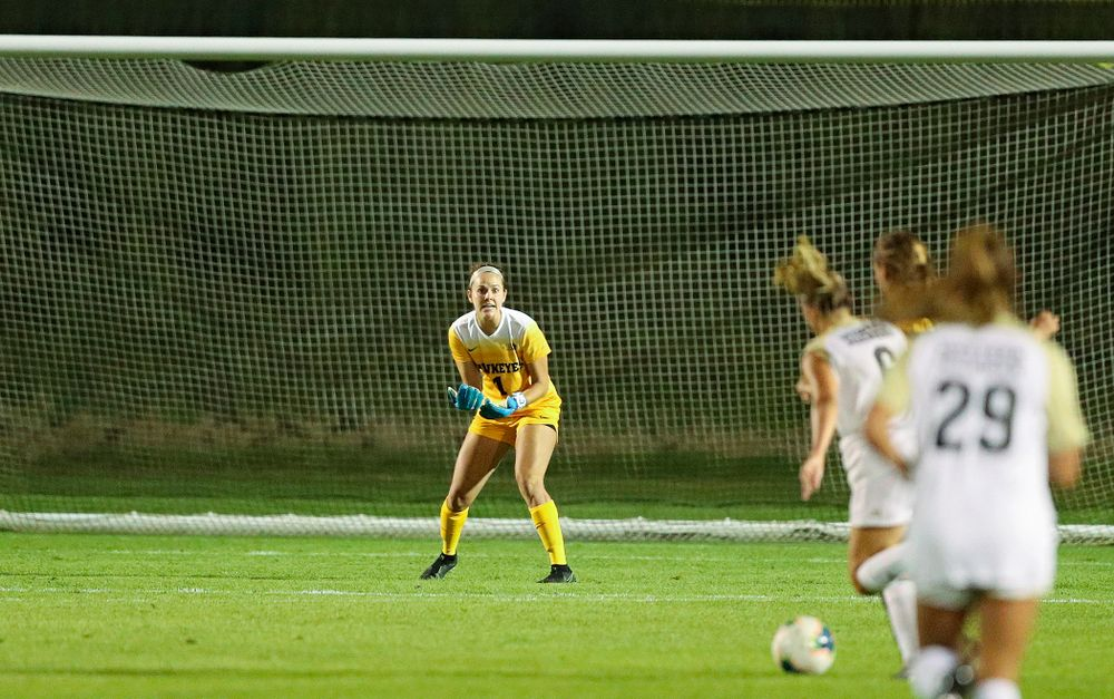 Iowa goalkeeper Claire Graves (1) shouts out instructions as she keeps her eyes on the ball during the second half of their match against Western Michigan at the Iowa Soccer Complex in Iowa City on Thursday, Aug 22, 2019. (Stephen Mally/hawkeyesports.com)
