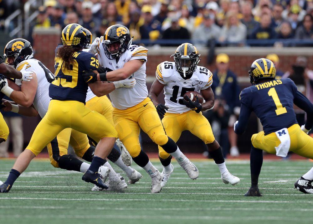 Iowa Hawkeyes running back Tyler Goodson (15) and fullback Brady Ross (36) against the Michigan Wolverines Saturday, October 5, 2019 at Michigan Stadium in Ann Arbor, MI. (Brian Ray/hawkeyesports.com)