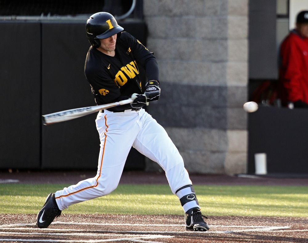 Iowa left fielder Austin Martin (34) gets a hit during the first inning of their game at Duane Banks Field in Iowa City on Tuesday, March 3, 2020. (Stephen Mally/hawkeyesports.com)