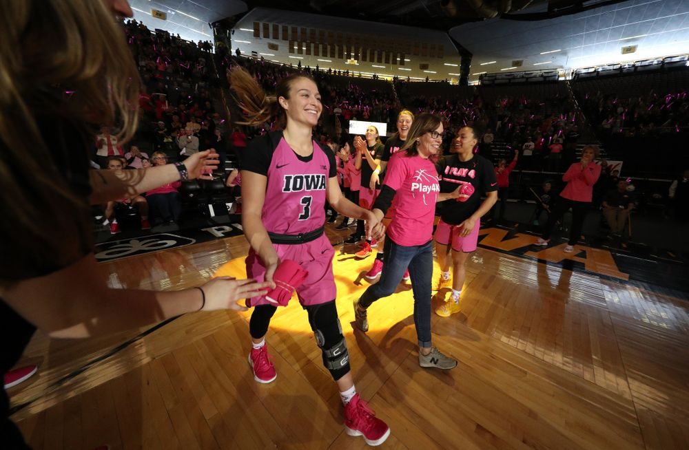 Iowa Hawkeyes guard Makenzie Meyer (3) is introduced with a cancer survivor before their game against the seventh ranked Maryland Terrapins Sunday, February 17, 2019 at Carver-Hawkeye Arena. (Brian Ray/hawkeyesports.com)