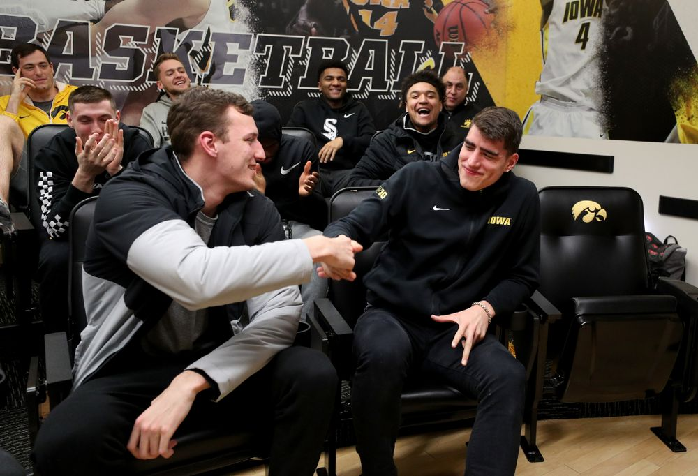 The Iowa Hawkeyes congratulate forward Luka Garza (55)  after finding out that he has been named the Big Ten Player of the Year Monday, March 9, 2020 at Carver-Hawkeye Arena. (Brian Ray/hawkeyesports.com)