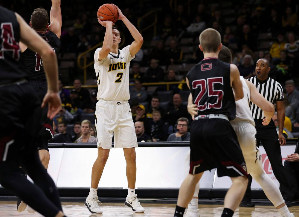 Iowa Hawkeyes forward Jack Nunge (2) puts up a 3-pointer during a game against Guilford College at Carver-Hawkeye Arena on November 4, 2018. (Tork Mason/hawkeyesports.com)