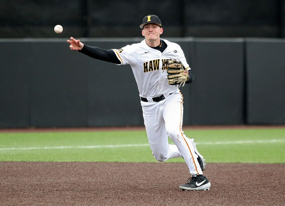 Iowa third baseman Brendan Sher (2) throws to first for an out during the second inning of their college baseball game at Duane Banks Field in Iowa City on Wednesday, March 11, 2020. (Stephen Mally/hawkeyesports.com)