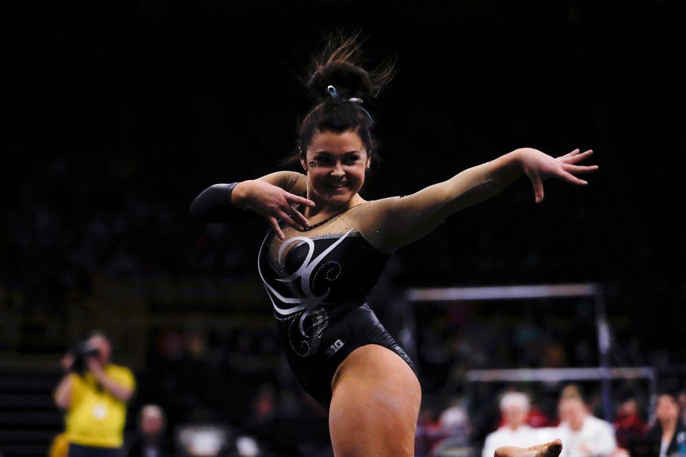 Iowa's Erin Castle competes on the floor against the Nebraska Cornhuskers