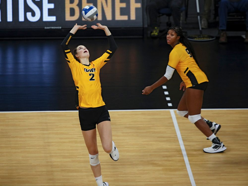 Iowa's Courtney Buzzerio (2) sets the ball for Amiya Jones (9) who gets a kill during the second set of their match against Illinois at Carver-Hawkeye Arena in Iowa City on Wednesday, Nov 6, 2019. (Stephen Mally/hawkeyesports.com)