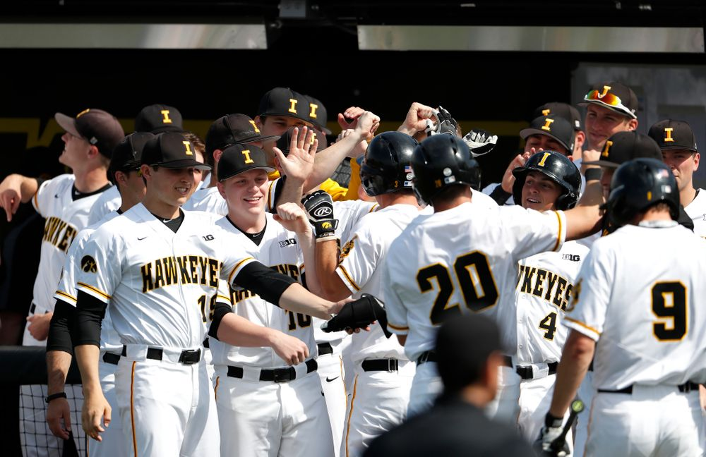 The Iowa Hawkeyes celebrate a run against the Missouri Tigers Tuesday, May 1, 2018 at Duane Banks Field. (Brian Ray/hawkeyesports.com)