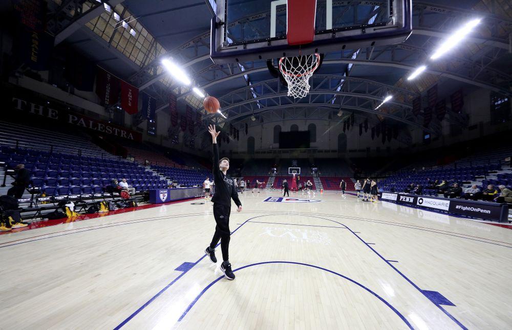 Jack McCaffery shoots baskets before practice at the Palestra Friday, January 3, 2020 in Philadelphia. (Brian Ray/hawkeyesports.com)