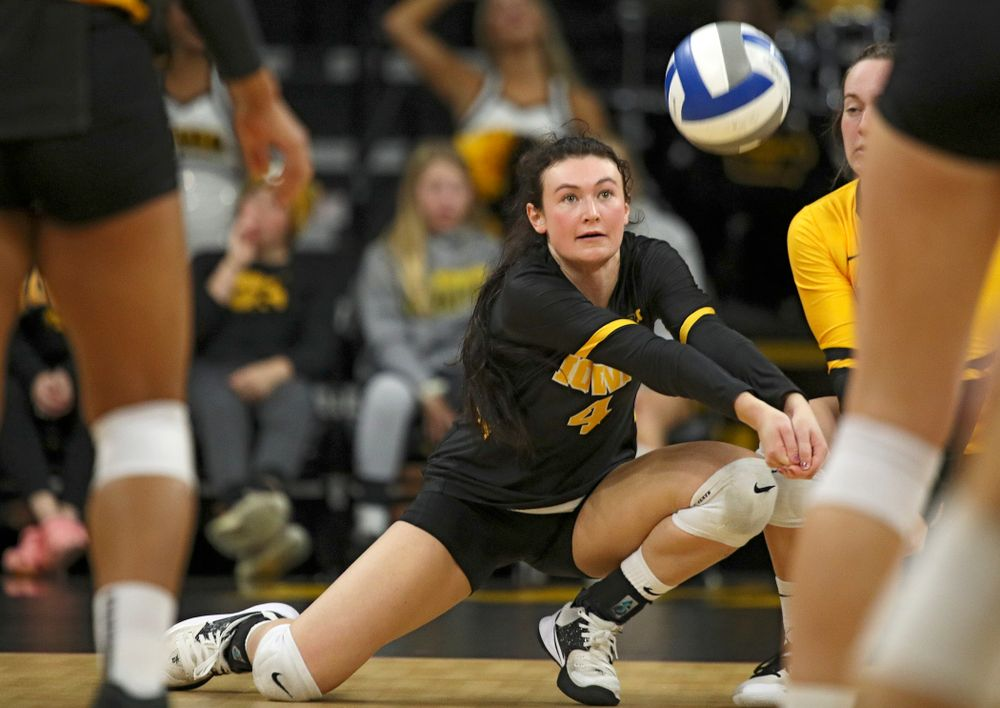 Iowa's Halle Johnston (4) gets a dig during their match at Carver-Hawkeye Arena in Iowa City on Sunday, Oct 20, 2019. (Stephen Mally/hawkeyesports.com)