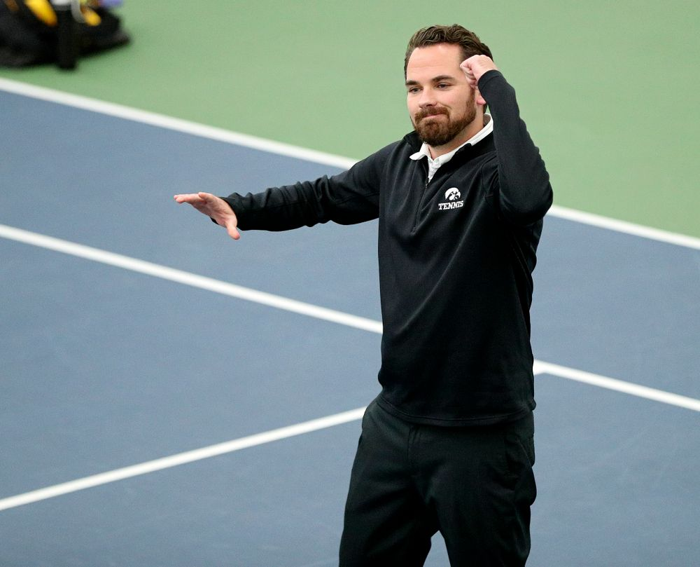 Iowa head coach Ross Wilson celebrates a point during their match at the Hawkeye Tennis and Recreation Complex in Iowa City on Thursday, January 16, 2020. (Stephen Mally/hawkeyesports.com)
