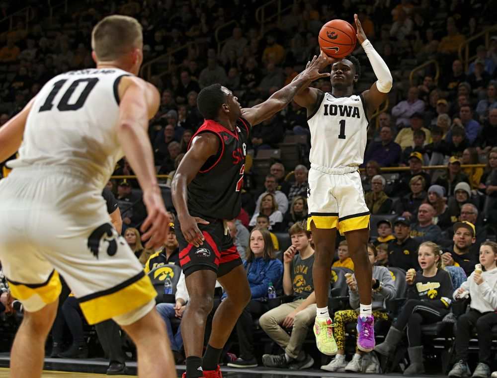 Iowa Hawkeyes guard Joe Toussaint (1) makes a 3-pointer during the first half of their game at Carver-Hawkeye Arena in Iowa City on Friday, Nov 8, 2019. (Stephen Mally/hawkeyesports.com)