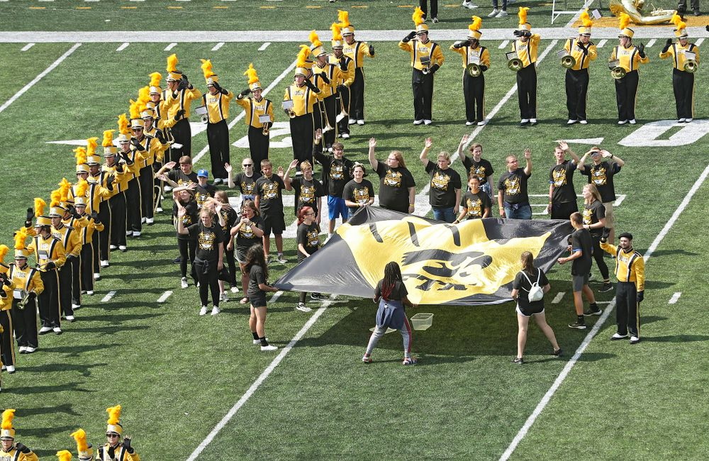 """The Hawkeye Marching Band on the field as Pat Green performs """"Wave on Wave"""" during the second quarter of their Big Ten Conference football game at Kinnick Stadium in Iowa City on Saturday, Sep 7, 2019. (Stephen Mally/hawkeyesports.com)"""