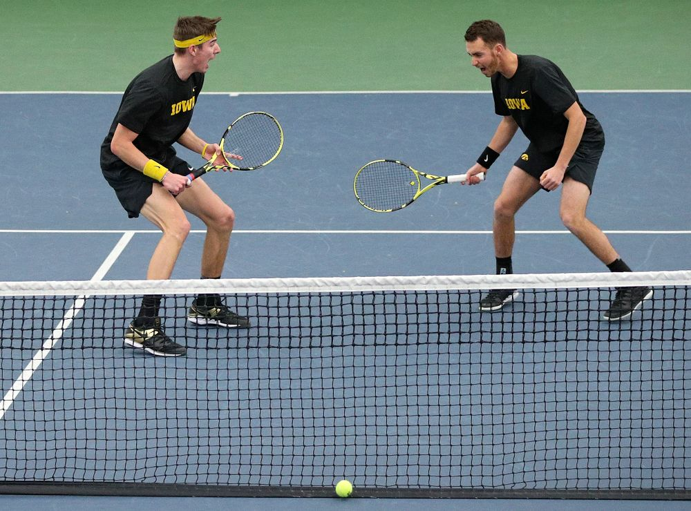 Iowa's Nikita Snezhko (from left) and Kareem Allaf celebrate a point during their doubles match against Marquette at the Hawkeye Tennis and Recreation Complex in Iowa City on Saturday, January 25, 2020. (Stephen Mally/hawkeyesports.com)