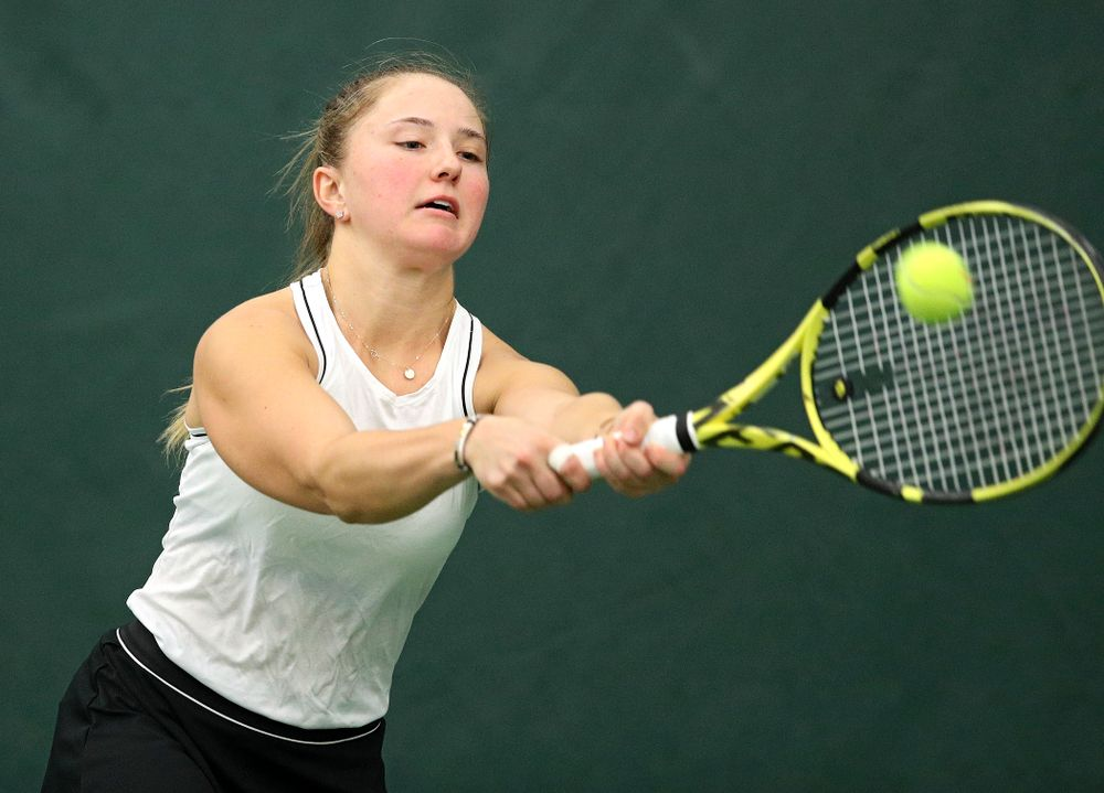 Iowa's Danielle Burich returns a shot during her doubles match at the Hawkeye Tennis and Recreation Complex in Iowa City on Sunday, February 16, 2020. (Stephen Mally/hawkeyesports.com)