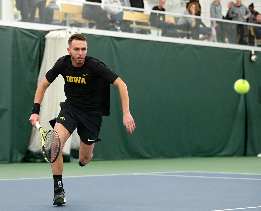 Iowa's Kareem Allaf runs down a ball during his singles match at the Hawkeye Tennis and Recreation Complex in Iowa City on Friday, February 14, 2020. (Stephen Mally/hawkeyesports.com)