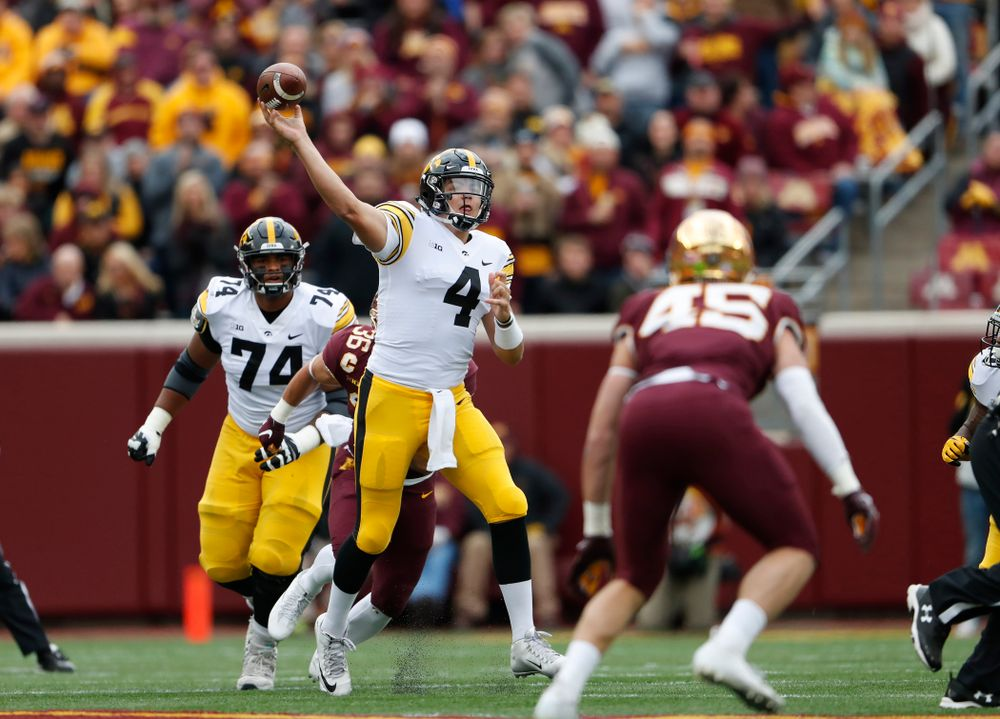 Iowa Hawkeyes quarterback Nate Stanley (4) throws a touchdown pass to wide receiver Ihmir Smith-Marsette (6) against the Minnesota Golden Gophers Saturday, October 6, 2018 at TCF Bank Stadium. (Brian Ray/hawkeyesports.com)