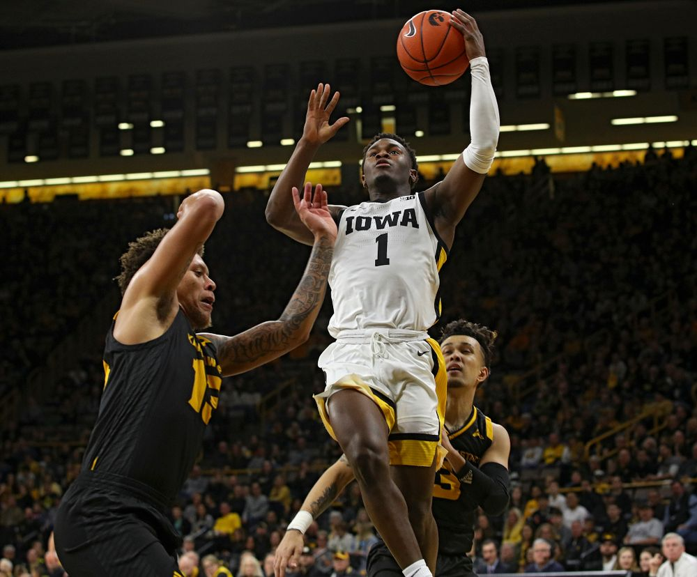 Iowa Hawkeyes guard Joe Toussaint (1) puts up a shot during the first half of their their game at Carver-Hawkeye Arena in Iowa City on Sunday, December 29, 2019. (Stephen Mally/hawkeyesports.com)