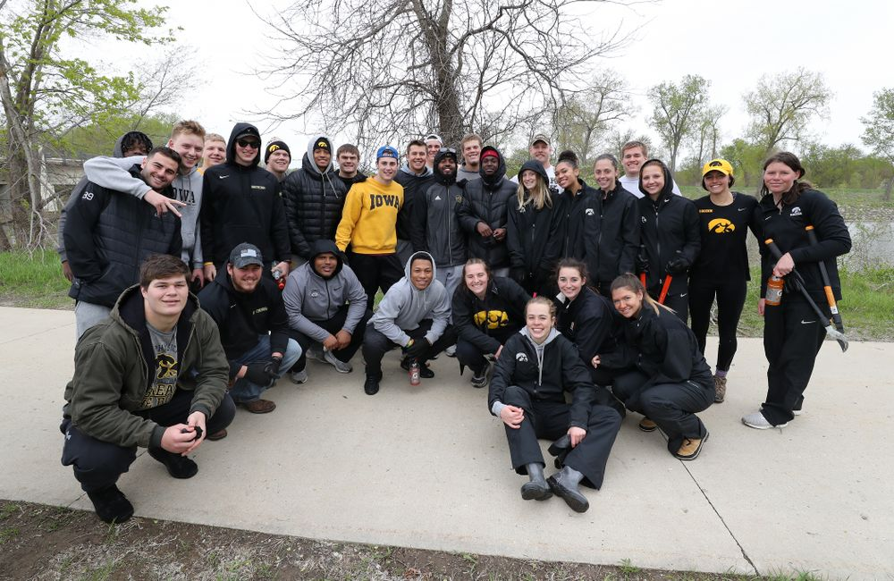 Members of the Hawkeye Football and Soccer teams volunteer with the Iowa City Public Works department along the Iowa River during the annual Iowa Athletics Day of Caring  Sunday, April 28, 2019 in Iowa City. (Brian Ray/hawkeyesports.com)