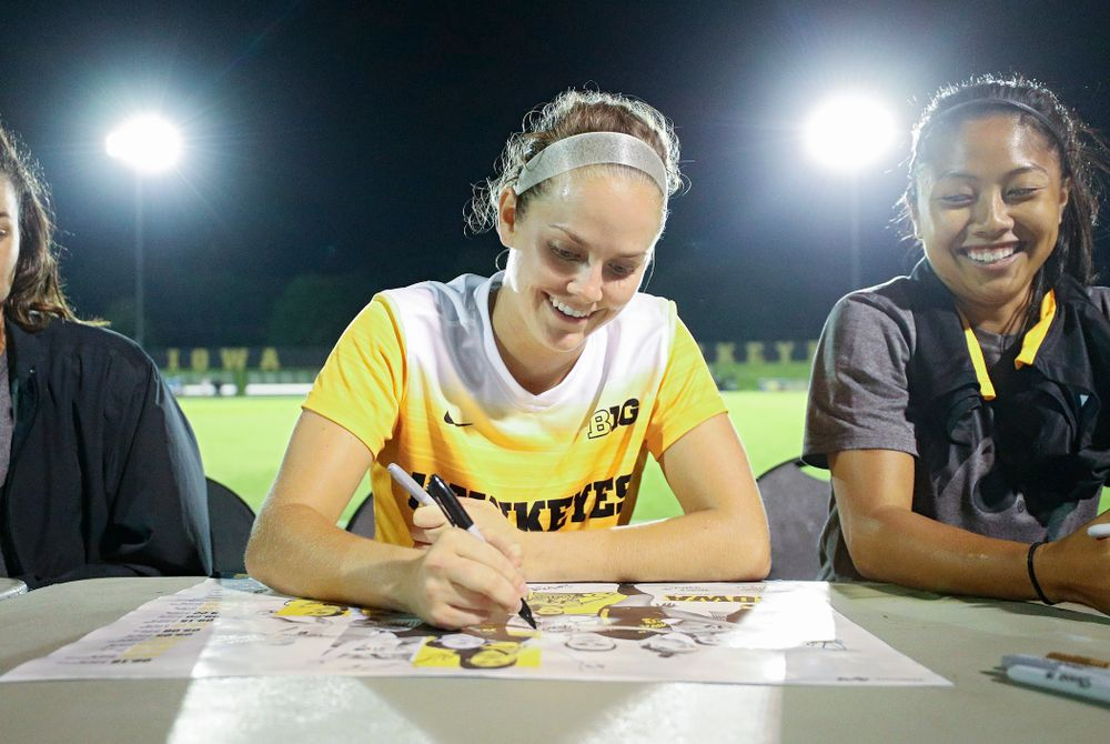 Iowa goalkeeper Claire Graves (1) signs a poster during an autograph session after their match against Western Michigan at the Iowa Soccer Complex in Iowa City on Thursday, Aug 22, 2019. (Stephen Mally/hawkeyesports.com)