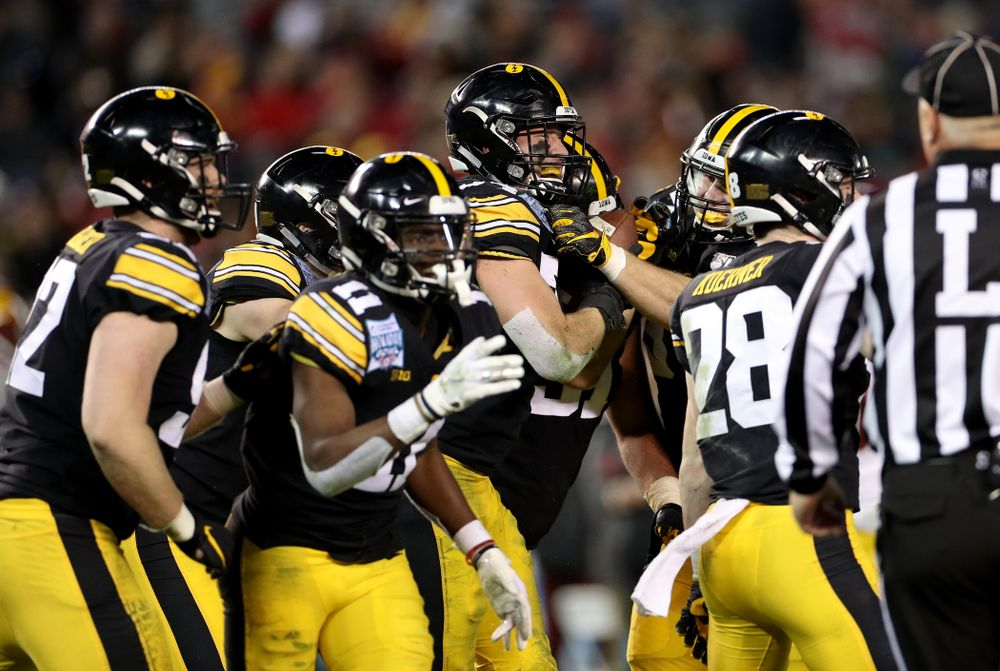 Iowa Hawkeyes linebacker Kristian Welch (34) celebrates after recovering a fumble against USC in the Holiday Bowl Friday, December 27, 2019 at San Diego Community Credit Union Stadium.  (Brian Ray/hawkeyesports.com)