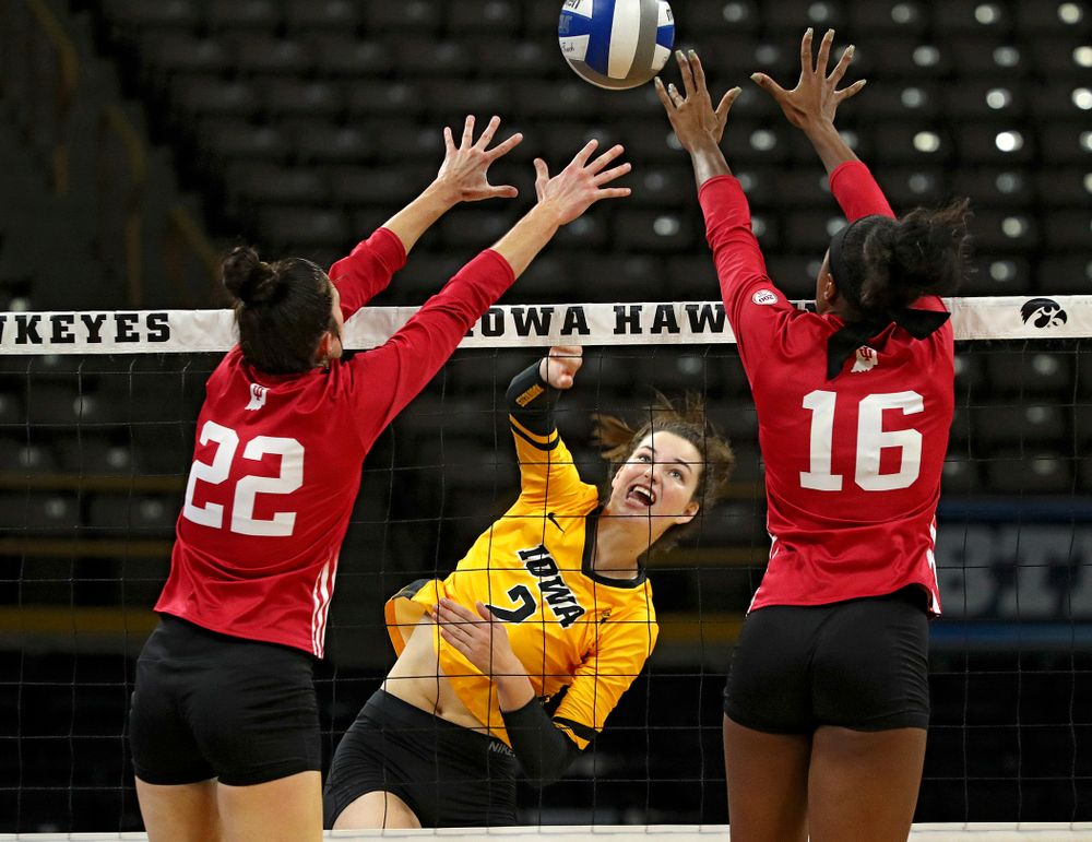 Iowa's Courtney Buzzerio (2) sends the ball over during their match at Carver-Hawkeye Arena in Iowa City on Sunday, Oct 20, 2019. (Stephen Mally/hawkeyesports.com)