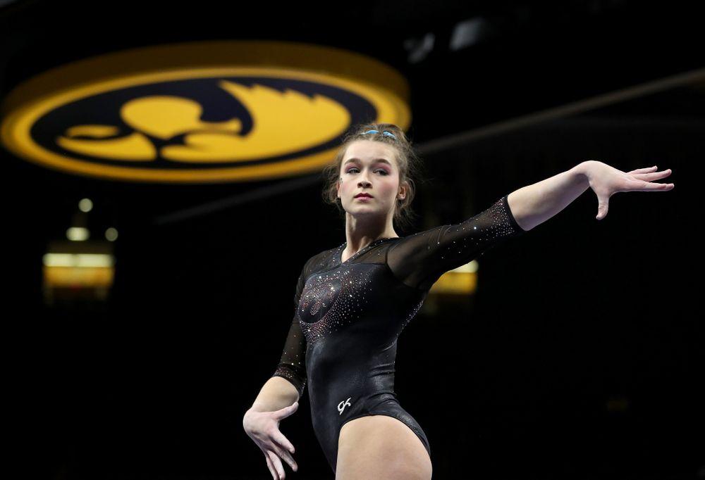 Iowa's Mackenzie Vance competes on the beam against Michigan Friday, February 14, 2020 at Carver-Hawkeye Arena. (Brian Ray/hawkeyesports.com)
