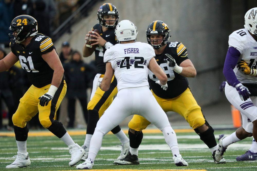 Iowa Hawkeyes offensive lineman Keegan Render (69) blocks during a game against Northwestern at Kinnick Stadium on November 10, 2018. (Tork Mason/hawkeyesports.com)