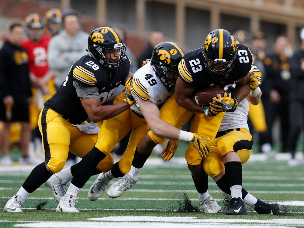 Iowa Hawkeyes wide receiver Dominique Dafney (23) and linebacker Nick Niemann (49) during the final spring practice Friday, April 20, 2018 at Kinnick Stadium. (Brian Ray/hawkeyesports.com)