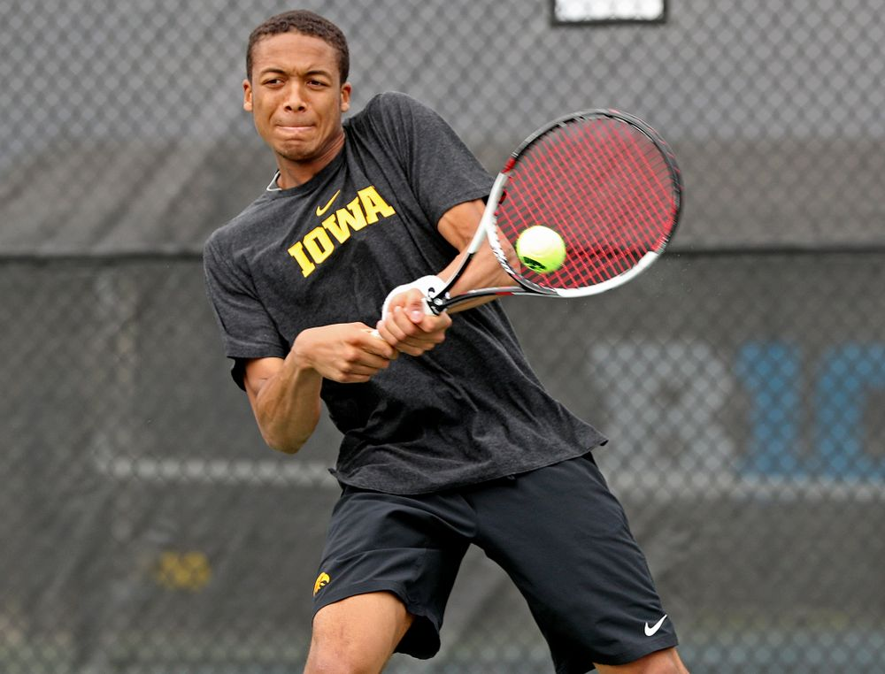 Iowa's Oliver Okonkwo competes during a double match against Ohio State at the Hawkeye Tennis and Recreation Complex in Iowa City on Sunday, Apr. 7, 2019. (Stephen Mally/hawkeyesports.com)