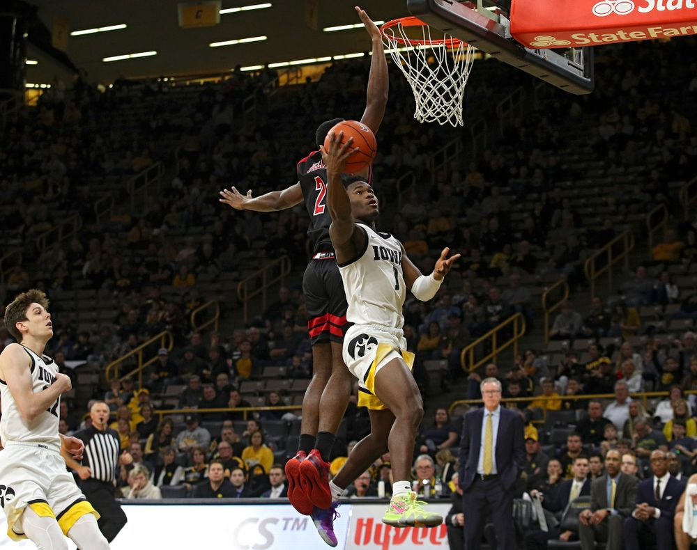 Iowa Hawkeyes guard Joe Toussaint (1) scores a basket during the second half of their game at Carver-Hawkeye Arena in Iowa City on Friday, Nov 8, 2019. (Stephen Mally/hawkeyesports.com)