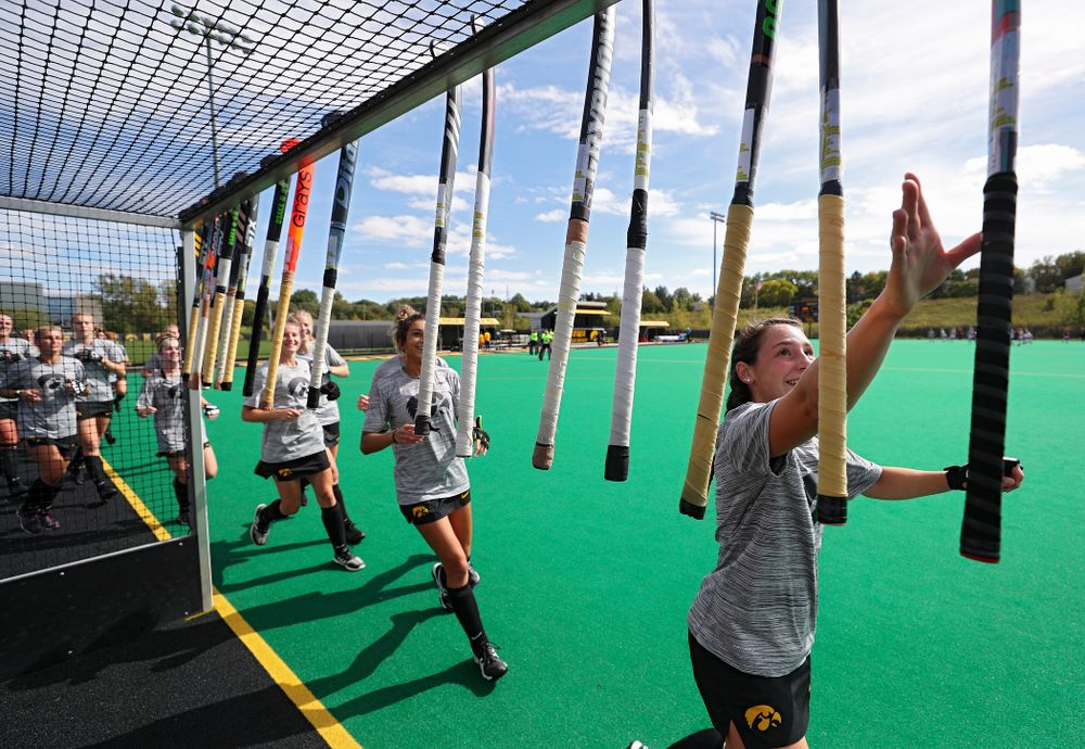 The Iowa Hawkeyes grab their sticks before the start of their match at Grant Field in Iowa City on Friday, Oct 4, 2019. (Stephen Mally/hawkeyesports.com)