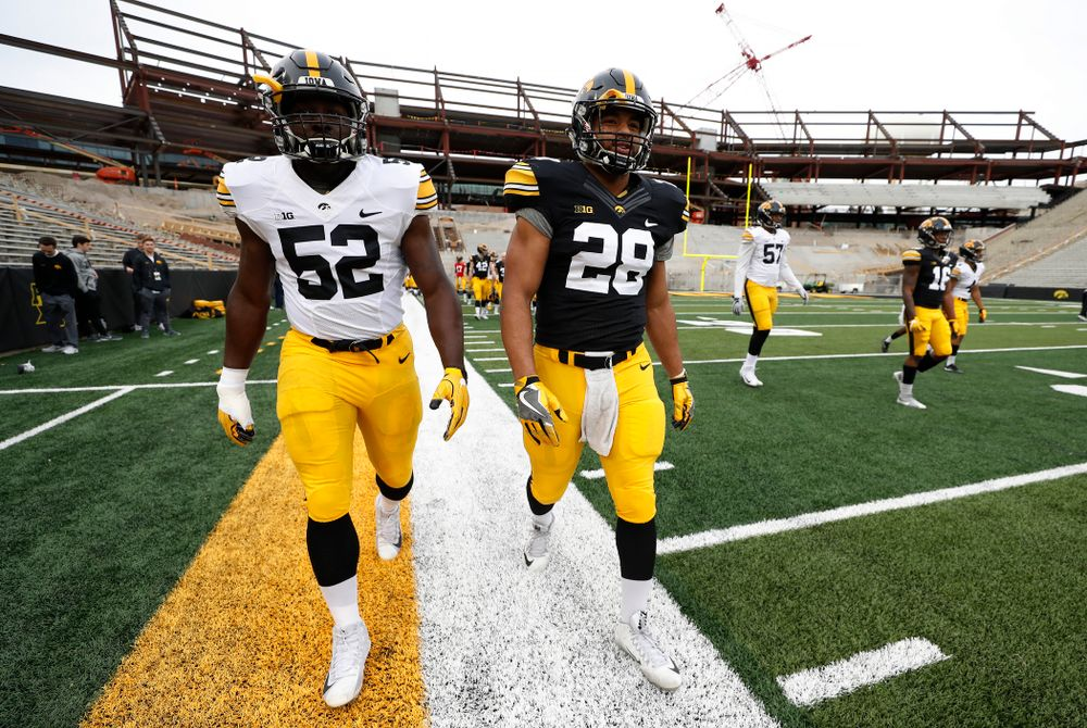 Iowa Hawkeyes linebacker Amani Jones (52) and running back Toren Young (28) during the final spring practice Friday, April 20, 2018 at Kinnick Stadium. (Brian Ray/hawkeyesports.com)