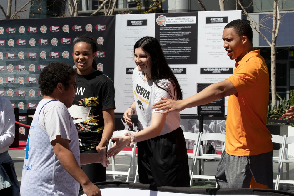Iowa Hawkeyes forward Megan Gustafson (10) and TennesseeÕs Grant Williams slap hands with the athletes following a Special Olympics Event Friday, April 12, 2019 in the XBOX Plaza at LA Live.  (Brian Ray/hawkeyesports.com)